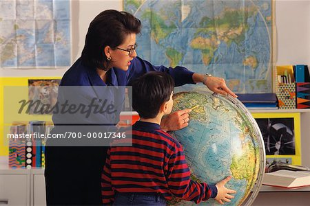 Female Teacher and Student in Classroom Looking at Globe Stock Photo - Rights-Managed, Image code: 700-00017346