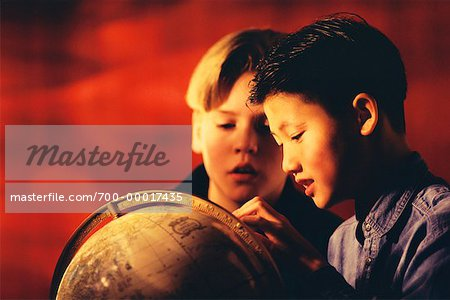 Two Boys Looking at Globe Stock Photo - Rights-Managed, Image code: 700-00017435