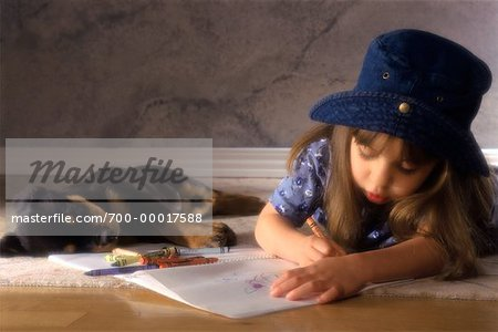 Girl Drawing with Crayons Beside Puppy