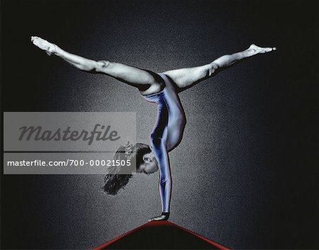 Female Gymnast Doing Handstand