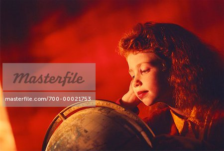 Girl Looking at Globe, Resting Head on Hand Stock Photo - Rights-Managed, Image code: 700-00021753