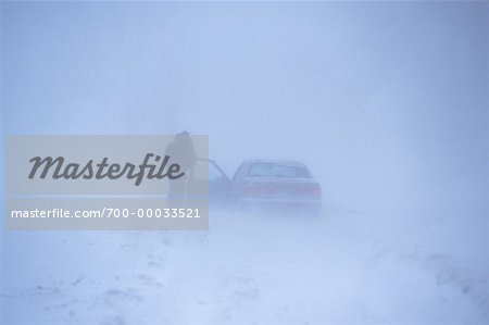 Man Standing Outside of Car in Snowstorm Southern Ontario, Canada Stock Photo - Rights-Managed, Image code: 700-00033521