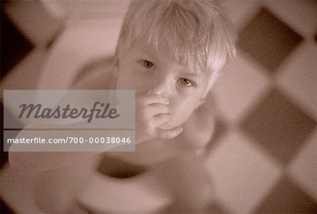 Portrait of Boy Sitting on Toilet Stock Photo - Rights-Managed, Image code: 700-00038046