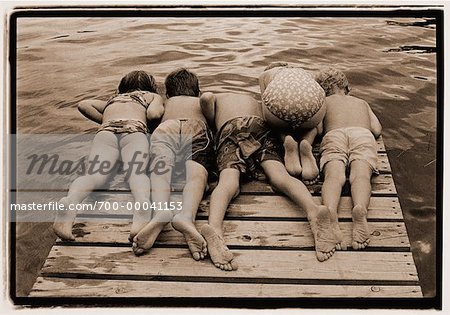 Back View of Children in Swimwear Looking over Edge of Dock Stock Photo - Rights-Managed, Image code: 700-00041153