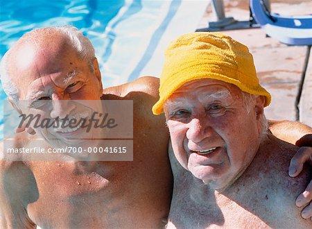 Portrait of Mature Men near Swimming Pool