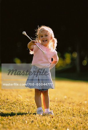 Girl Twirling Baton Outdoors Stock Photo - Rights-Managed, Image code: 700-00044777