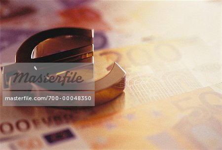 Close-Up of Euro Symbol with European Currency Stock Photo - Rights-Managed, Image code: 700-00048350