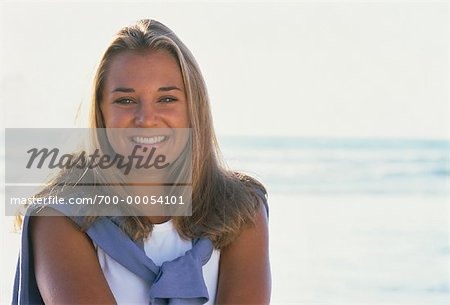 Portrait of Teenage Girl with Sweater Over Shoulders, Smiling Outdoors    Stock Photo - Premium Rights-Managed, Artist: David Schmidt, Code: 700-00054101