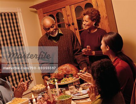Grandfather Bringing Turkey to Thanksgiving Dinner Table Stock Photo - Rights-Managed, Image code: 700-00055597