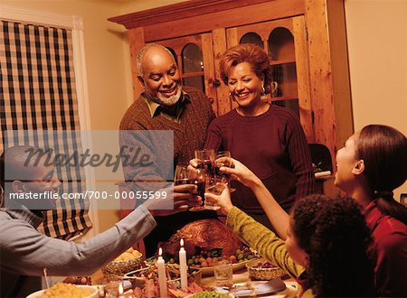 Family Toasting with Glasses at Thanksgiving Dinner Table Stock Photo - Rights-Managed, Image code: 700-00055599