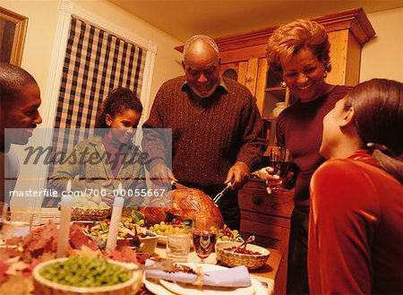 Grandfather Carving Turkey at Thanksgiving Dinner Table Stock Photo - Rights-Managed, Image code: 700-00055667