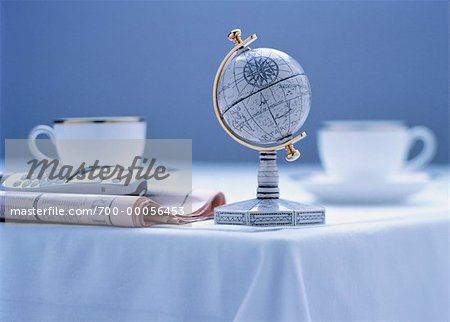 Small Globe, Newspaper, Cell Phone and Cups on Table Stock Photo - Rights-Managed, Image code: 700-00056453
