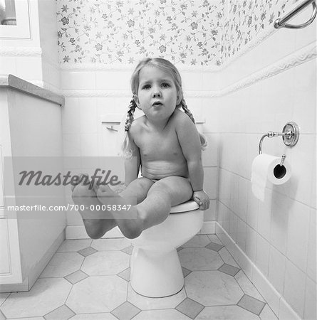 Portrait of Girl Sitting on Toilet Stock Photo - Rights-Managed, Image code: 700-00058347