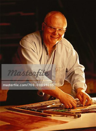 Portrait of Mature Male Stained Glass Artisan in Workshop