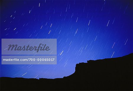 Star Trails and Silhouette of Rock Formation Utah, USA