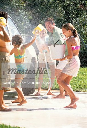 Family Washing Car, Having Water Fight Stock Photo - Rights-Managed, Image code: 700-00065610