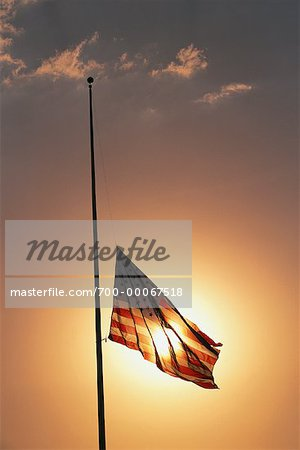 American Flag at Half Mast at Sunset Stock Photo - Rights-Managed, Image code: 700-00067518