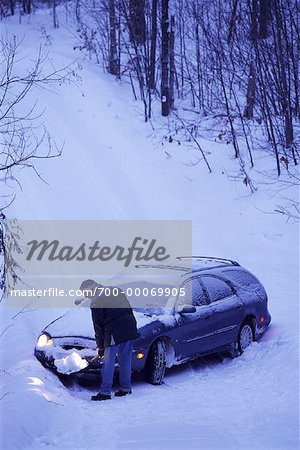 Mature Man Shovelling Snow in Front of Car Stock Photo - Rights-Managed, Image code: 700-00069905