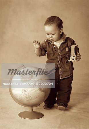 Boy Standing near Spinning Globe Stock Photo - Rights-Managed, Image code: 700-00070704