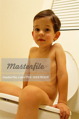 Portrait of Nude Boy Sitting on Toilet Stock Photo - Rights-Managed, Image code: 700-00070920