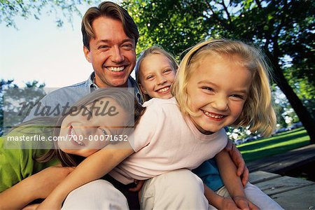 Father with Daughters, Laughing Outdoors Stock Photo - Rights-Managed, Image code: 700-00071632
