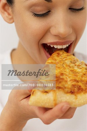Portrait of Woman Eating Slice of Pizza Stock Photo - Rights-Managed, Image code: 700-00074683