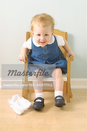 Girl Sitting in Potty Chair Stock Photo - Rights-Managed, Image code: 700-00077311
