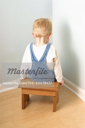 Back View of Boy Sitting in Corner Stock Photo - Rights-Managed, Image code: 700-00078437