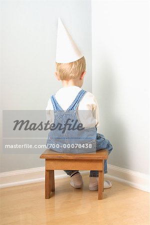 Back View of Boy Sitting in Corner Stock Photo - Rights-Managed, Image code: 700-00078438