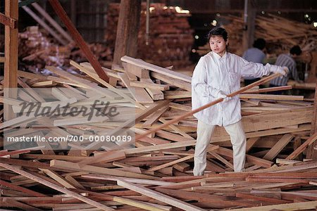 Woman Working in Sawmill Bangkok, Thailand