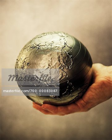 Globe in Palm of Hand Pacific Rim Stock Photo - Rights-Managed, Image code: 700-00083087
