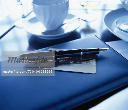 Fountain Pen, Credit Card and Bill Holder on Restaurant Table Stock Photo - Rights-Managed, Image code: 700-00085293
