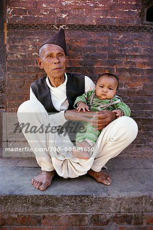 Portrait of Mature Man with Baby Kathmandu Valley, Nepal Stock Photo - Rights-Managed, Image code: 700-00086650
