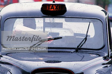 Driver Reading Newspaper in Taxi Glasgow, Scotland Stock Photo - Rights-Managed, Image code: 700-00094724