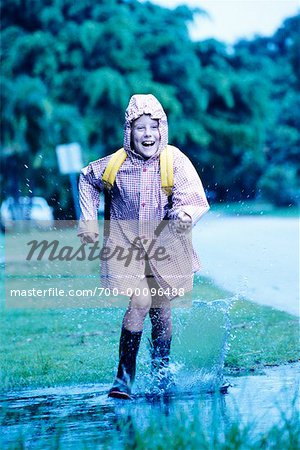 Child Running Through Puddle in Raincoat and Boots Stock Photo - Rights-Managed, Image code: 700-00096488