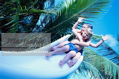 Two Boys on Water Slide Stock Photo - Premium Rights-Managed, Artist