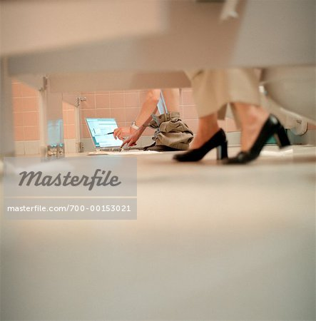 Women's Feet and Laptop Computer in Bathroom Stalls Stock Photo - Rights-Managed, Image code: 700-00153021