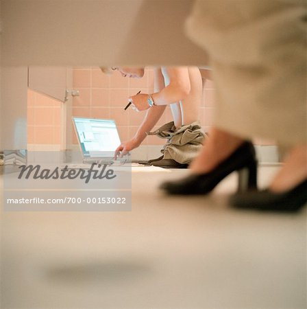 Women's Feet and Laptop Computer in Bathroom Stalls Stock Photo - Rights-Managed, Image code: 700-00153022