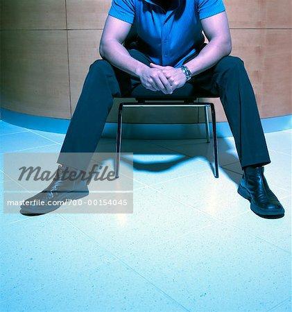 Headless Man Sitting on Chair