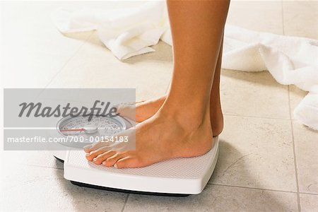 Close Up of Woman's Feet on Bathroom Scale