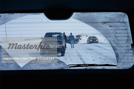 Car Accident in Winter as Seen Through Rear View Window Stock Photo - Rights-Managed, Image code: 700-00158364
