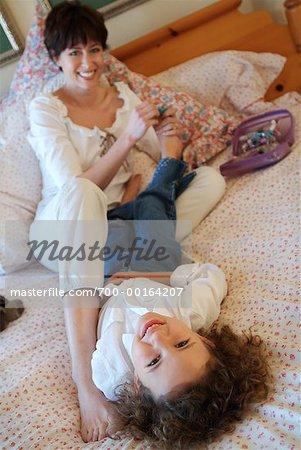Mother Tickling Daughter's Feet