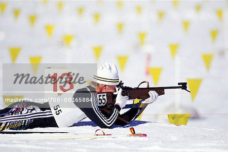 Biathlon Athlete Lying Down Shooting at Target Stock Photo - Rights-Managed, Image code: 700-00165884