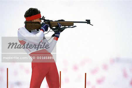 Biathlon Athlete Shooting At Target Stock Photo - Rights-Managed, Image code: 700-00165885