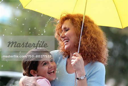 Mother and Daughter with Umbrella in the Rain Stock Photo - Rights-Managed, Image code: 700-00177533
