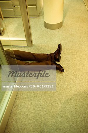 Man Lying on Floor Stock Photo - Rights-Managed, Image code: 700-00179253