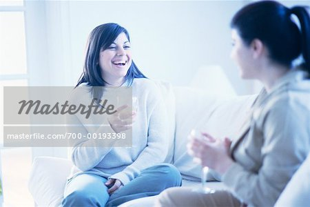Women Sitting on Sofa Drinking Wine Stock Photo - Rights-Managed, Image code: 700-00193398