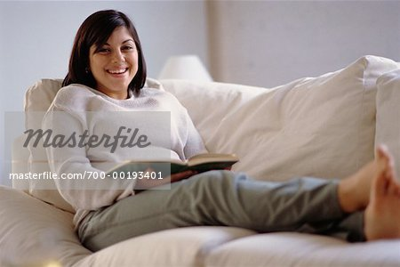 Woman Reading on Sofa Stock Photo - Rights-Managed, Image code: 700-00193401