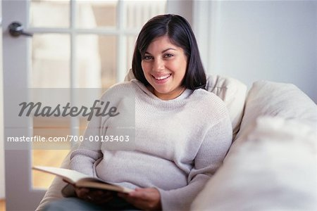Woman Reading on Sofa Stock Photo - Rights-Managed, Image code: 700-00193403