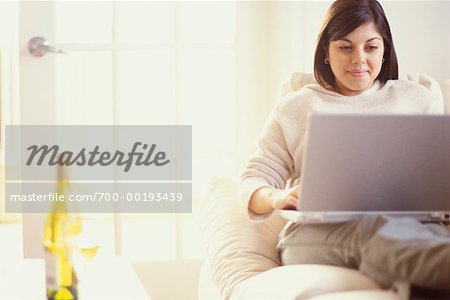Woman on Sofa Using Laptop Stock Photo - Rights-Managed, Image code: 700-00193439